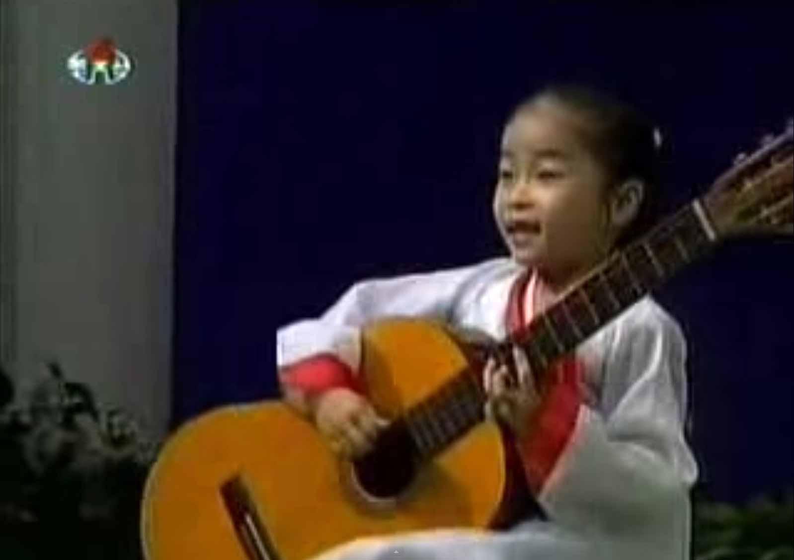 North korean girl playing guitar