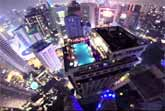 Urban BASE Jumper Crashes A Rooftop Pool Party